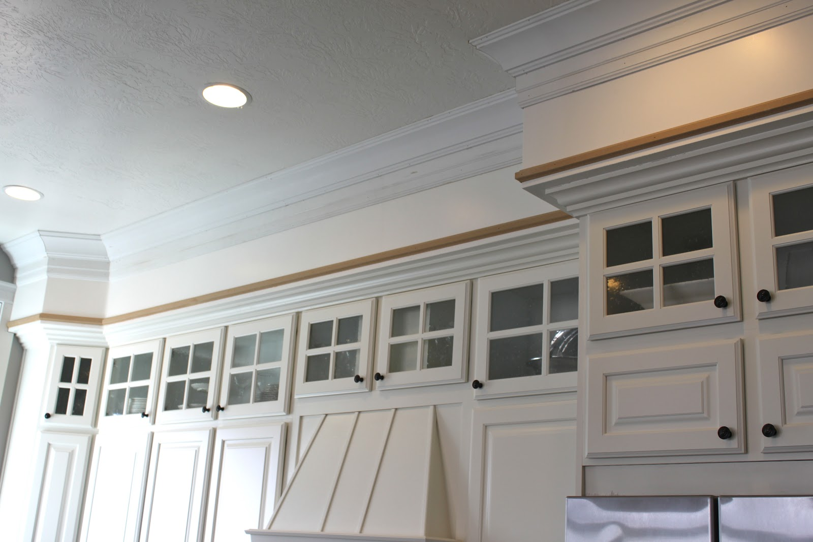Low ceilings soffits and opening up your kitchen designeric for Bulkhead over kitchen cabinets